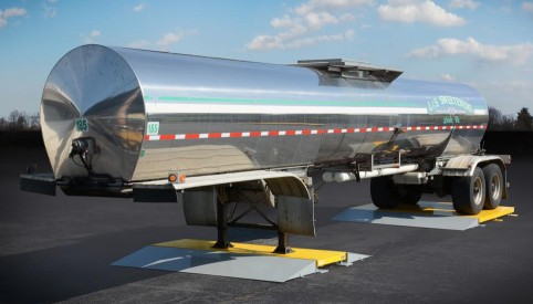 silver liquid tank hauler parked on tanker weigh scale