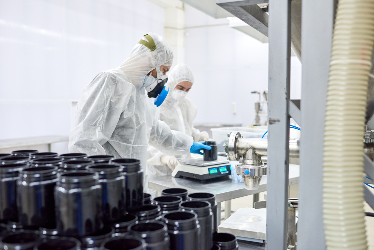 Pharmaceutical Plant Workers Using Scale