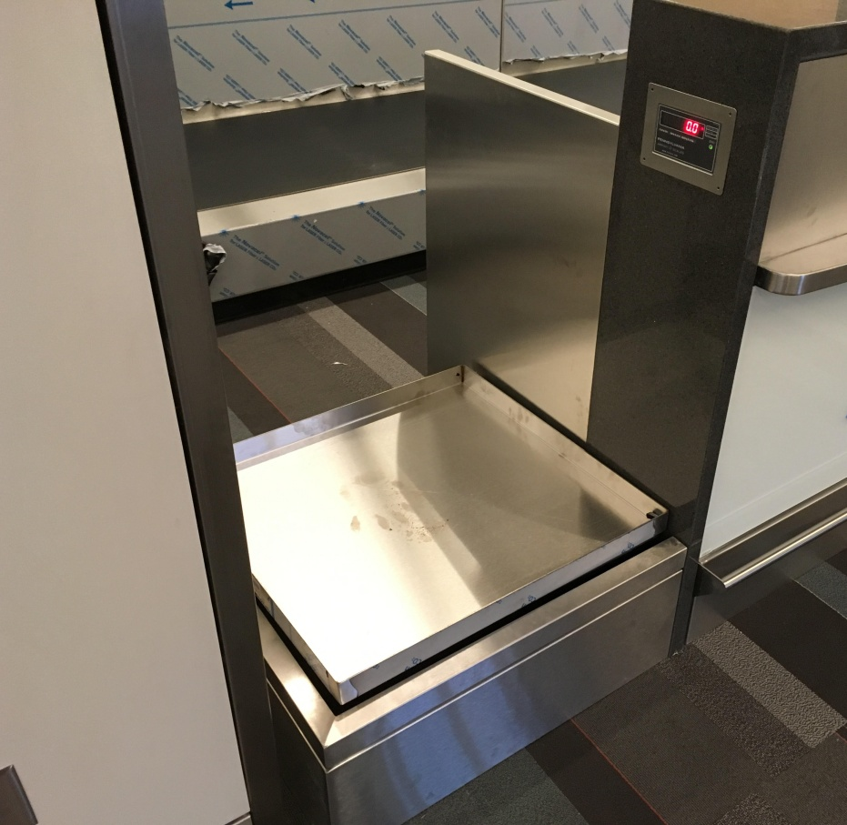 low profile baggage scale at airport terminal